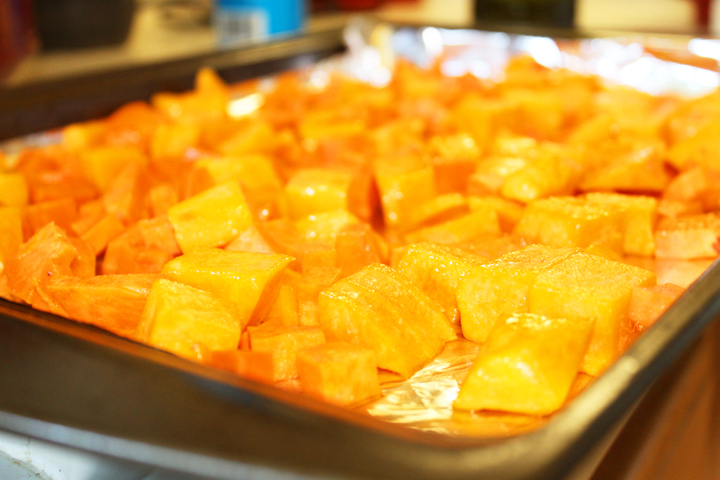 Butternut Squash and Sweet Potatoes getting ready to roast for the Sweet Potato Butternut Squash Miso Mash recipe via www.agutsygirl.com