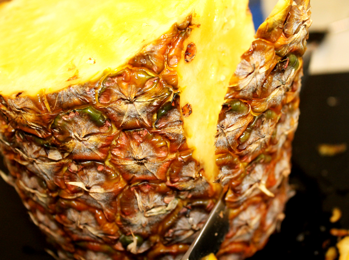 cut off all spikes while the pineapple stands: how to cut a whole pineapple www.agutsygirl.com