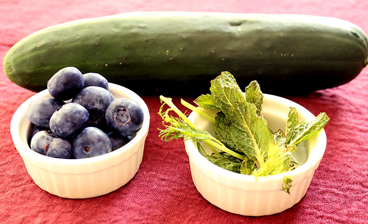 just a few ingredients. cucumber & blueberry summer salad with homemade blueberry vinaigrette #recipe via www.agutsygirl.com #glutenfree #grainfree #dairyfree