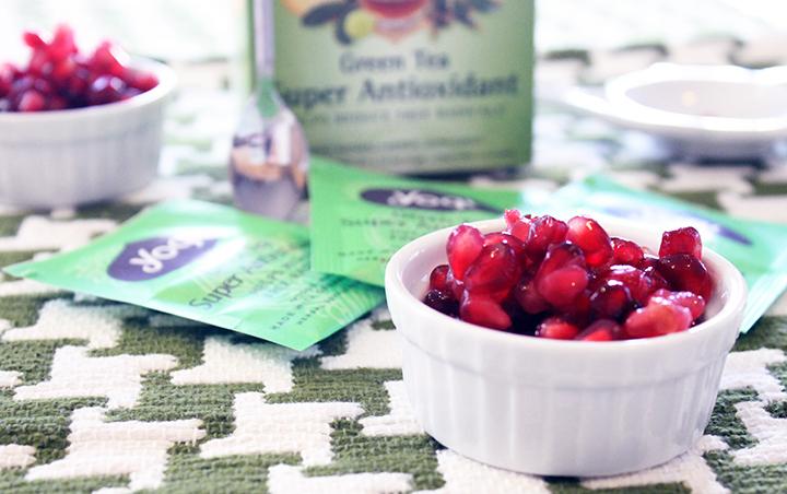 Yogi Green Tea and Pomegranate Seeds. How to Drink More Green Tea via www.agutsygirl.com