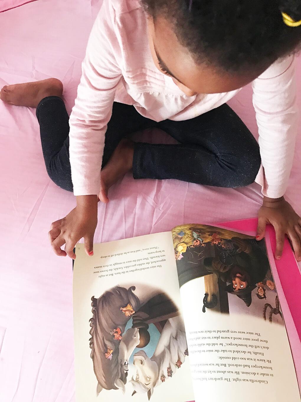 Her Favorite Disney Princess sarahkayhoffman.com Samarah reading in her dream tent