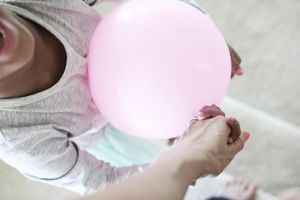 Happy Birthday, Samarah {This is Five} www.sarahkayhoffman.com Sam holding SKH hand balloon #lifestyleblogger #birthday