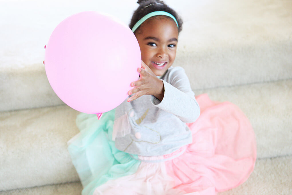 Happy Birthday, Samarah {This is Five} www.sarahkayhoffman.com sam with balloon #lifestyleblogger #birthday