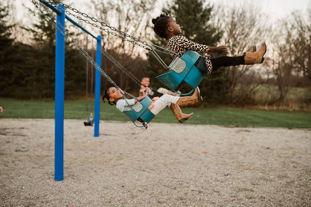 This is Us www.sarahkayhoffman.com #adoption #fostercareadoption #adopt #lifestyleblogger swinging swing set playground