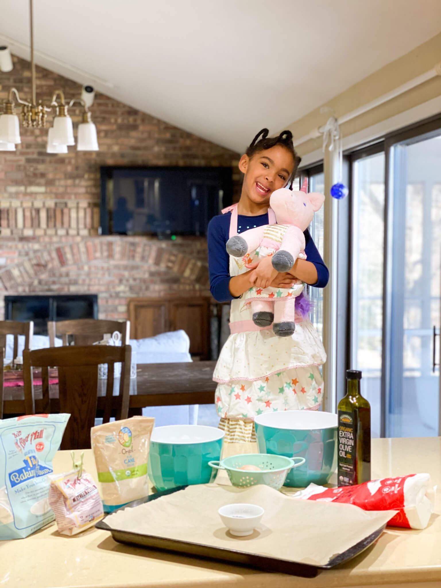 Gluten and Dairy-Free Almond Poppy Seed Sheet Cake Recipe agutsygirl.com #glutenfreerecipe #dairyfreerecipe #glutenfreedairyfree #poppyseed Samarah and Unicorn kids baking