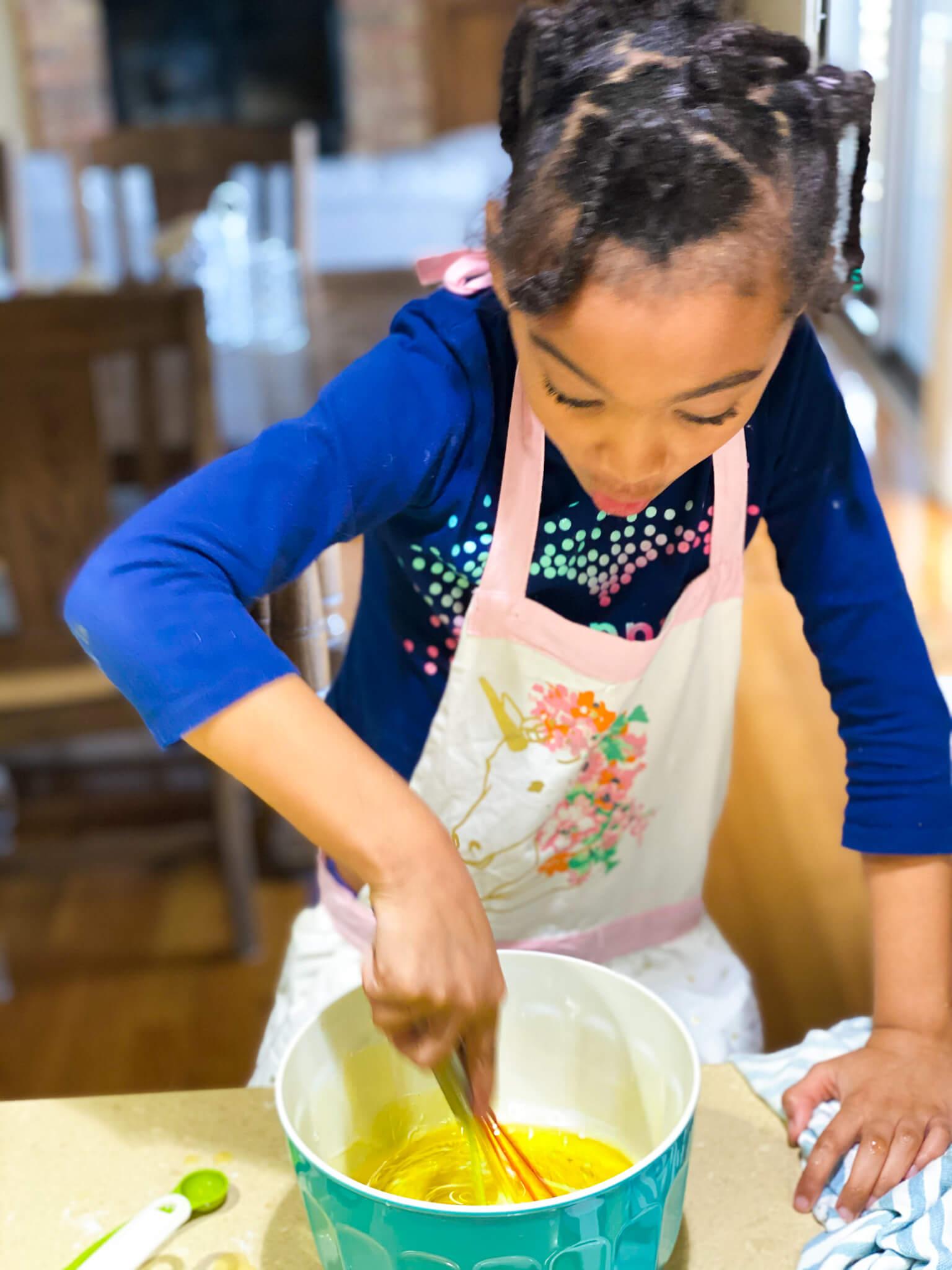 Gluten and Dairy-Free Almond Poppy Seed Sheet Cake Recipe agutsygirl.com #glutenfreerecipe #dairyfreerecipe #glutenfreedairyfree #poppyseed Samarah mixing