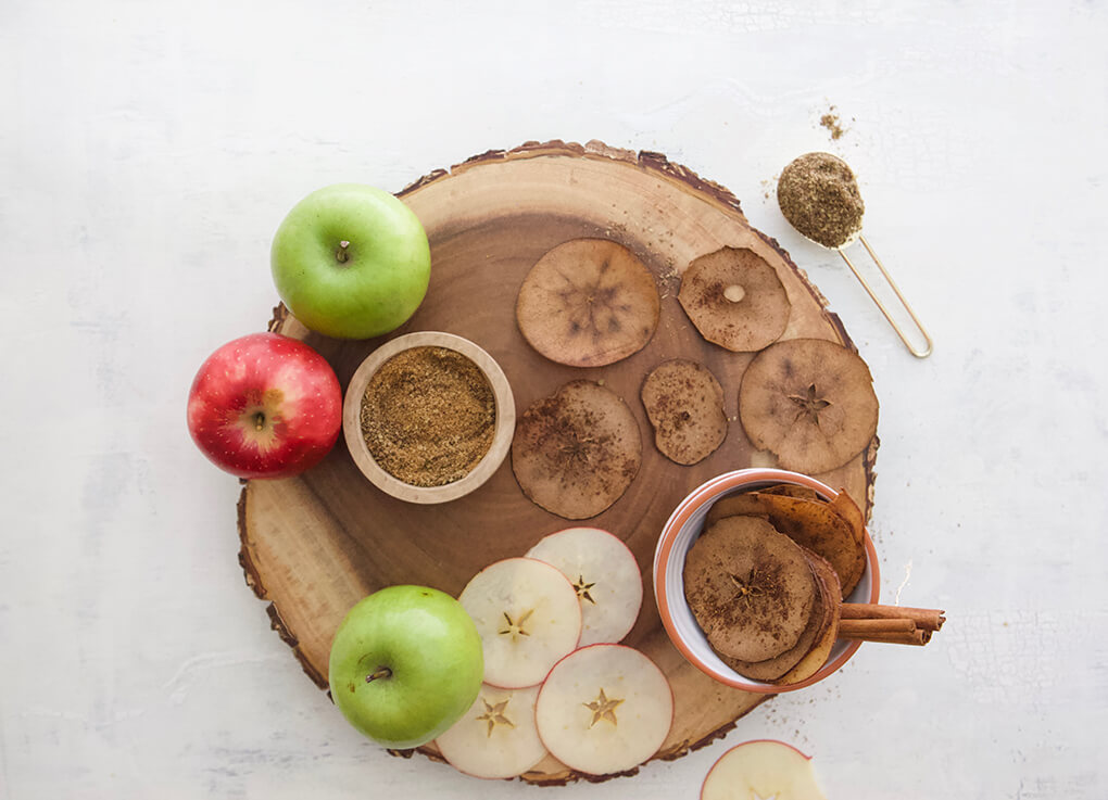 3-Ingredient Baked Apple Chips agutsygirl.com #applechips #glutenfreerecipes #apples autumn